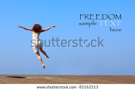 funny jump of young woman. freedom. - stock photo