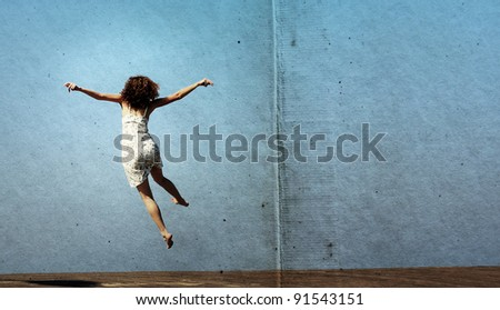 funny jump of young woman. freedom. Photo in old image style. - stock photo