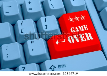 Funny keyboard with text Game Over on Enter button. - stock photo