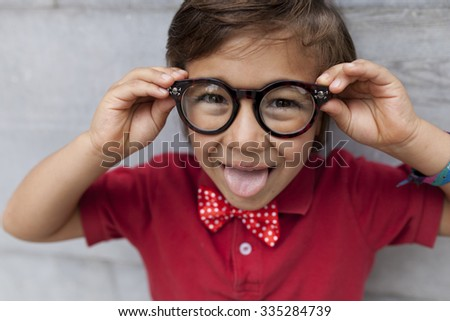 funny kid face with glasses - stock photo