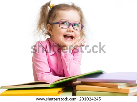 Funny kid girl in glasses reading books - stock photo