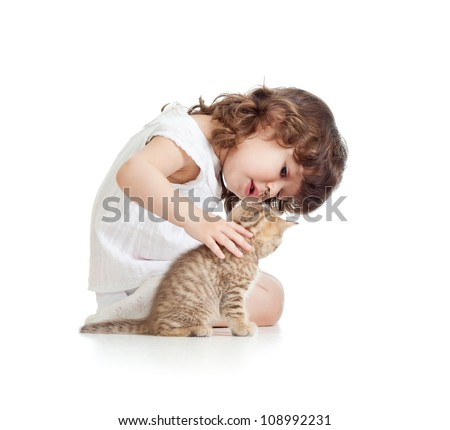 Funny kid girl playing with cat kitten - stock photo
