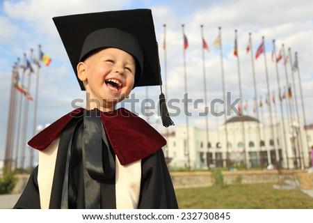 funny kid graduate - stock photo