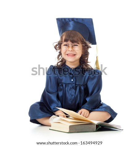 funny kid in academician clothes  with book - stock photo