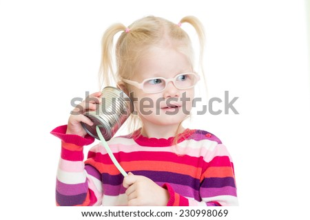 Funny kid in eyeglasses using a can as a telephone isolated on white - stock photo