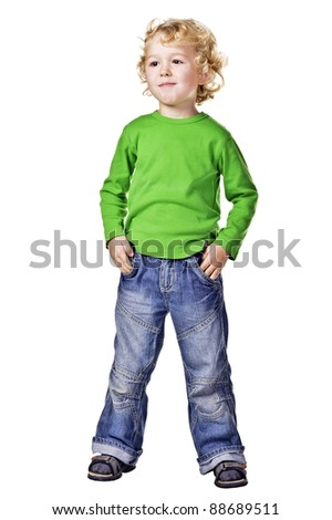 Funny Kid in jeans and green sweater. Isolated over white