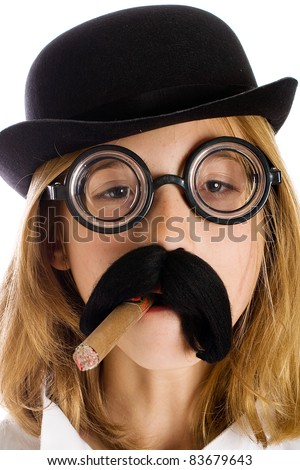 Funny kid wearing a silly costume with a fake mustache, cigar and bowler cap.