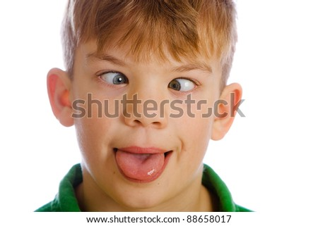 Funny kid with a silly expression on his face. - stock photo