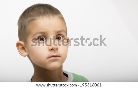 Funny kid with eyes wide open  - stock photo