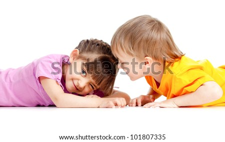 Funny kids boy and girl playing together - stock photo