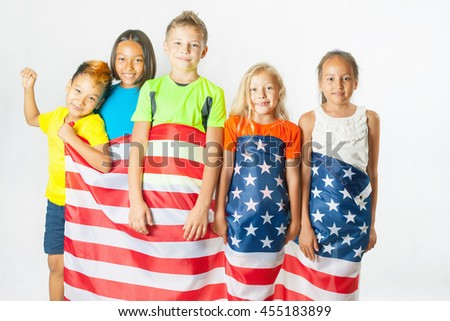 Funny kids holding american national flag. Group of school children. Multiethnic students. Friends. Fans, 2016. White background - stock photo