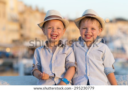 funny kids laughing in the sun