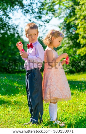 funny kids on a holiday makes soap bubbles