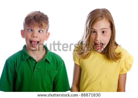 Funny kids with silly expressions on their face. - stock photo