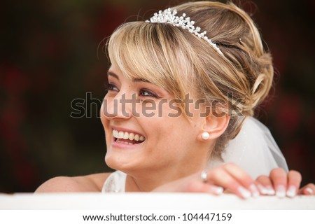 Funny laughing bride portrait on her wedding day.Face photo of a beautiful happy and pretty woman with diadem in her hair - stock photo