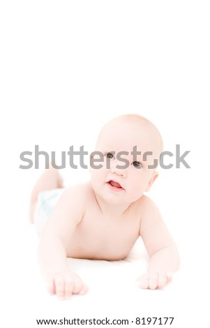 Funny little baby lying on white bed over white background - stock photo