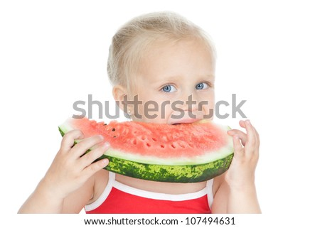 Funny little blonde girl eating a ripe watermelon over white