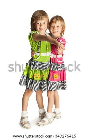 Funny little blonde girl holding hands - Isolated on white background.The concept of a Happy childhood and child development - stock photo