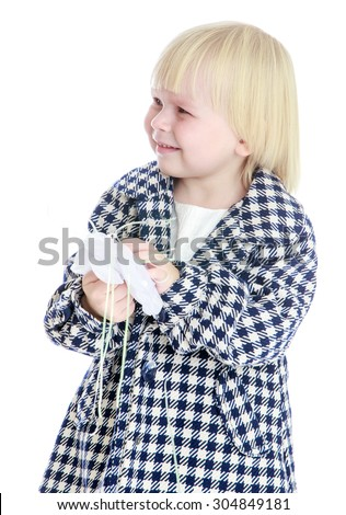 Funny little blonde girl with a short haircut Bob in the autumn plaid coat holding a bow. Closeup-Isolated on white background - stock photo