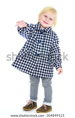 Funny little blonde girl with short hair to wave his arms. A girl wearing a plaid coat and gray jeans-Isolated on white background - stock photo