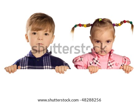 Funny little boy and girl holding a blank white sign for your message. Good for borders of articles or websites. Beautiful caucasian model. Isolated on white background. - stock photo