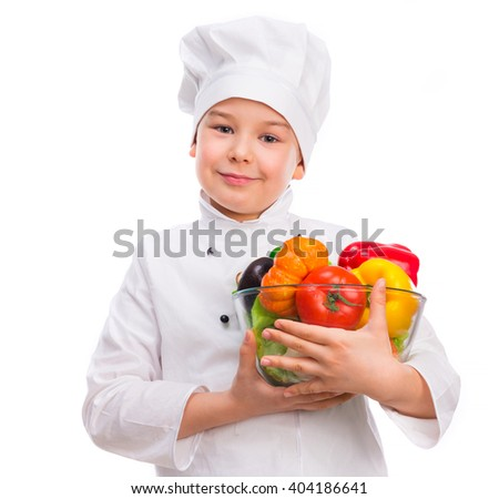funny little boy-cook holding bowl with vegetables in hands - stock photo