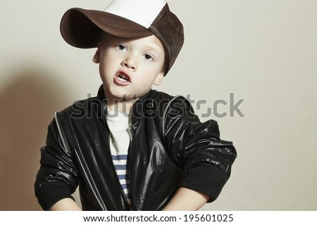 Funny little boy.Hip-Hop Style. fashion children.handsome.Pose Boy in Tracker Hat. Young Rapper. Funny Child in Cap. 4 years old - stock photo
