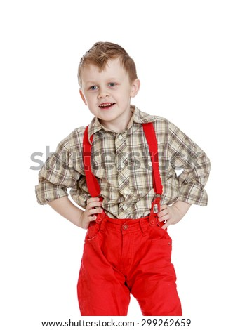 Funny little boy in a plaid shirt and red shorts with straps, close-up-Isolated on white background - stock photo