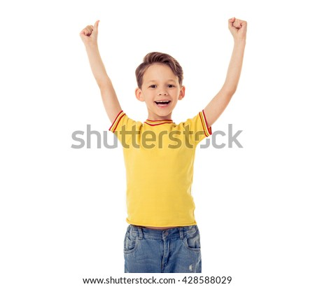 Funny little boy keeping hands in fists up, looking at camera and smiling, isolated on a white background - stock photo