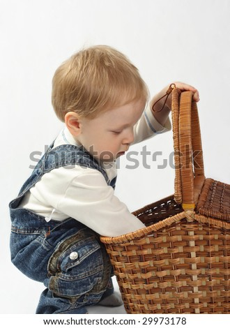 Funny little boy looking into the basket