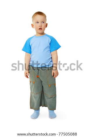 Funny little boy stands isolated on white background - stock photo