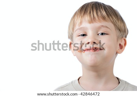 funny little boy with chocolate on the face  isolated on white - stock photo