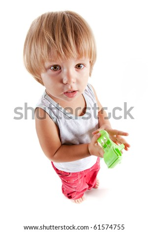 Funny little boy with toy, high angle view - stock photo
