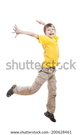 Funny little child in colorful t-shirt jumping and laughing over white background  - stock photo