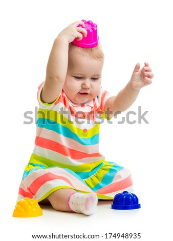 Funny little child is playing with toys - stock photo