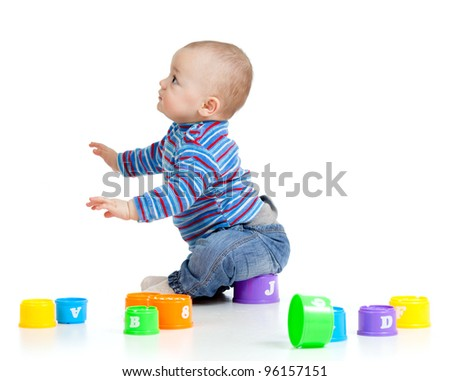 Funny little child is playing with toys, isolated over white - stock photo