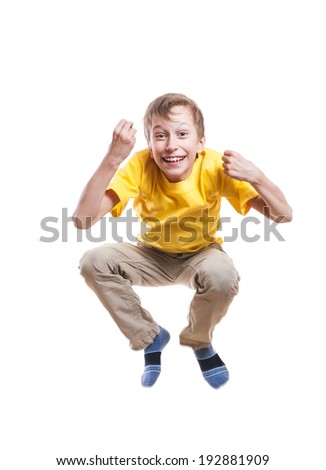 Funny little child jumping and laughing over white background  - stock photo