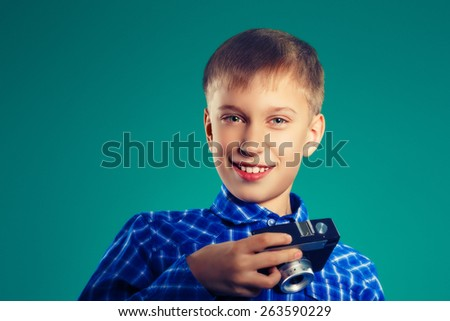 Funny little child traveler with vintage camera. Travel and vacation concept. (soft focus, filtered) - stock photo
