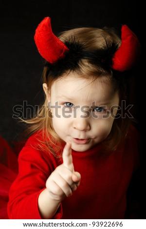 funny little devil points up - stock photo
