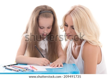 funny little girl and mother drawing using color pencils isolated on white background