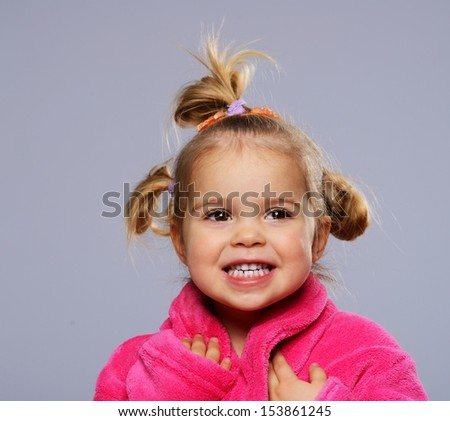 Funny little girl in dressing gown - stock photo