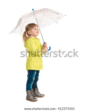 funny little girl in yellow coat holding umbrella in hand isolated on white background - stock photo