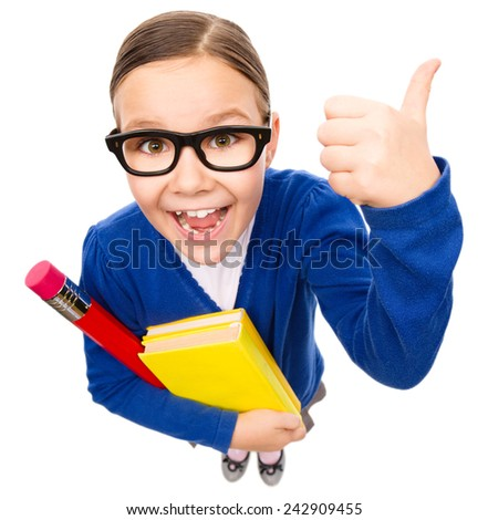 Funny little girl is holding books and showing thumb up sign, fisheye portrait, isolated over white - stock photo