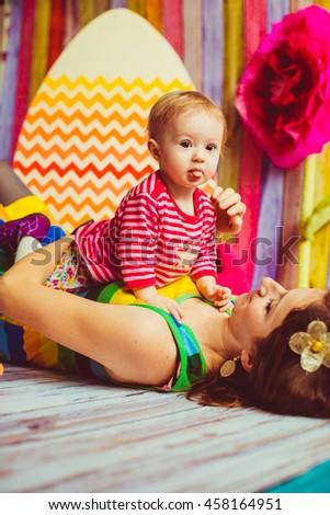 funny little girl lying on her mother - stock photo