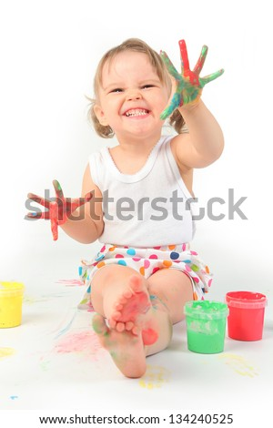 funny little girl painting on white - stock photo