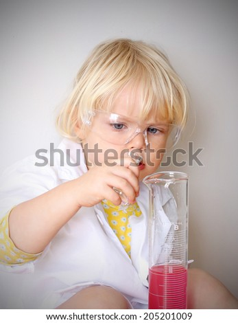 Funny little girl playing chemistry. Science concept.  - stock photo