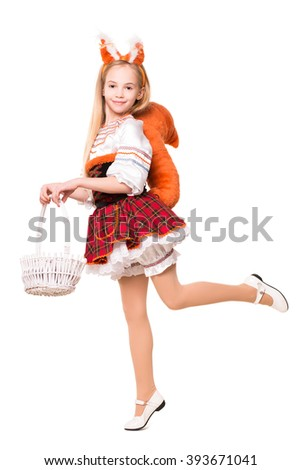 Funny little girl posing in a squirrel costume with basket. Isolated on white - stock photo