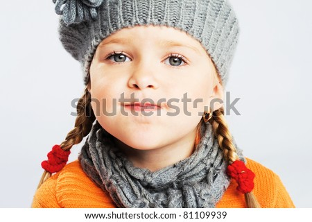 Funny little girl pulling a face - stock photo