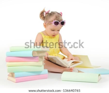 funny little girl reading books - stock photo