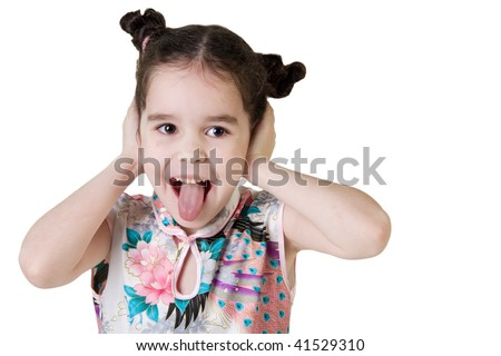 Funny little girl showing her tongue - stock photo